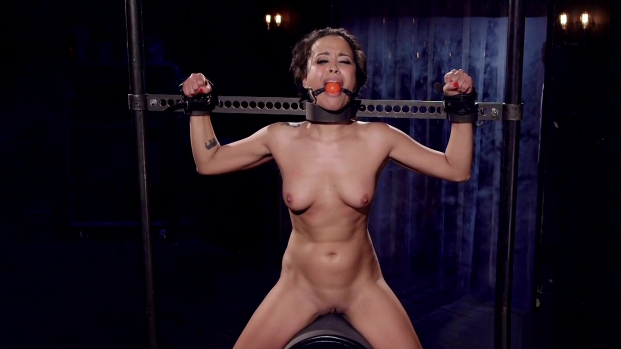 Tanned slut hard flogged in bondage